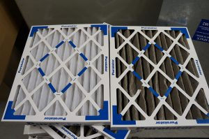 Air filters comparison: clean and dirty.